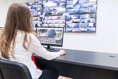 Surveillance control room operator at work stock photos