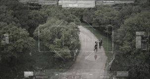 Surveillance drone camera view of terrorist squad walking with weapons. Military surveillance drone view of terrorists walking through a forest stock video