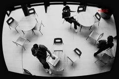 Surveillance Screen Showing Nurses In Hospital Canteen. View of three nurses in hospital canteen through surveillance screen Stock Images