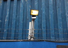 Surveillance Search Light on Blue Metal Background Royalty Free Stock Photography