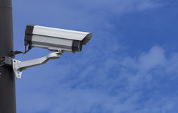 Surveillance Security Camera or CCTV on blue sky Stock Photography