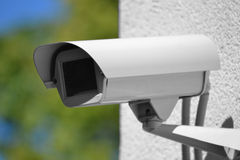 Surveillance, security camera, monitoring, CCTV. Security camera installed on a building Stock Images