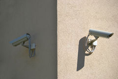 Surveillance, security camera, monitoring, CCTV. Security camera installed on a building Stock Photography