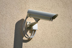 Surveillance, security camera, monitoring, CCTV. Security camera installed on a building Royalty Free Stock Photos