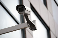 Surveillance, security camera, monitoring, CCTV. Security camera installed on a building Stock Photo
