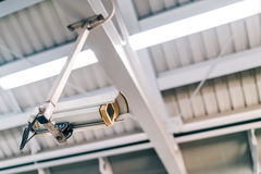 Surveillance security CCTV camera on the roof at night, safety or security concept stock photography