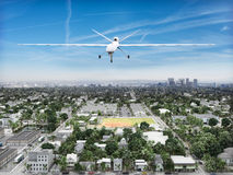Surveillance UAV drone. Flying over a residential neighborhood . Government is watching concept stock photography