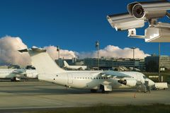 Surveillance video camera, airplanes, airport. Surveillance video camera is controlling the modern airport . Sky area is free for your text Stock Photos