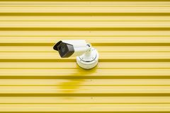 Surveillance video camera isolated on yellow royalty free stock photography
