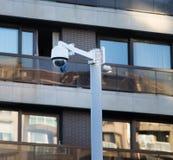Surveillance video camera over street road stock photo
