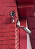 Surveillance Video Camera on  wall Stock Images