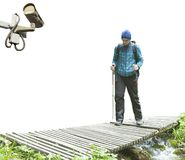 Surveillane camera watching young man. Travel on mountain Royalty Free Stock Photography