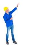 Surveillant avec la main augmentée tenant le presse-papiers Photographie stock