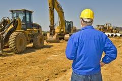 Surveillant de construction donnant sur Job Site Photo libre de droits