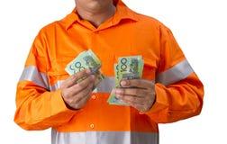Surveillant ou homme de travail avec la participation élevée de chemise de visibilité et le c Image stock