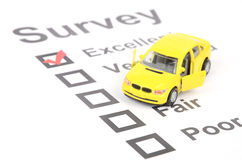 Survey. Page and yellow toy car Stock Image