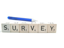 Survey. The word survey with a pen in the background royalty free stock images