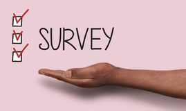 Survey background with checkboxes and hand. Conceptual survey background. Caucasian hand over analysis backdrop with text and marked checkboxes. Feedback Royalty Free Stock Photos