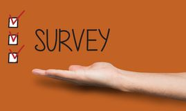 Survey background with checkboxes and hand. Conceptual survey background. Caucasian hand over analysis backdrop with text and marked checkboxes. Feedback Stock Image
