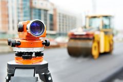 Survey equipment at asphalting Royalty Free Stock Photo