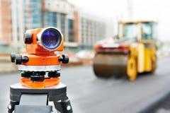 Survey equipment at asphalting royalty free stock photo