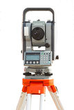 Survey equipment theodolite on a tripod. Isolated on white backg Royalty Free Stock Images