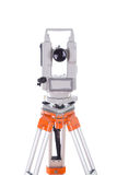 Survey equipment theodolite on a tripod. Isolated on white Royalty Free Stock Image