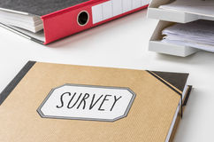 Survey. A folder with the label Survey royalty free stock photography