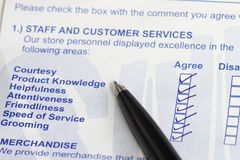 Survey form. Business values - satisfied customers concept with a survey form royalty free stock photos