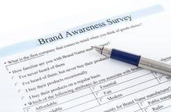 Survey form and pen. Survey form brand awareness survey Stock Image