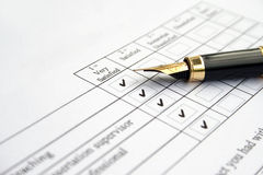 Survey form- very satisfied. Filling out a survey form- checked very satisfied royalty free stock images