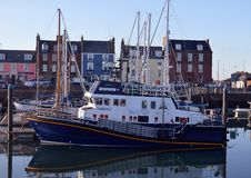 Survey vessel moored in Arbroath Harbour, Scotland Stock Images