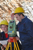 Surveying. Geodesy team with GEO station Royalty Free Stock Photography