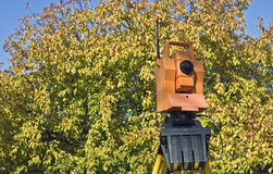 Surveying during colorful fall Stock Photo