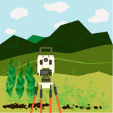 Surveying. Device surveyor - a theodolite, is in an open area in the mountains, beautiful natural scenery Stock Photos