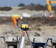 Surveying equipment at construction site Royalty Free Stock Images