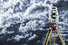 Surveying instrument measuring horizon Stock Photo