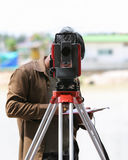Surveying measuring equipment level theodolite on tripod at cons Stock Images