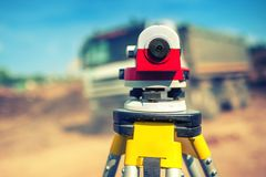 Surveying measuring equipment level theodolite on tripod Royalty Free Stock Image