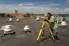 Surveying rooftop Royalty Free Stock Photo