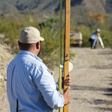 A Surveying Team Works on a Road Stock Photography