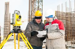 Surveying works at construction Stock Images