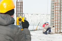 Surveying works at construction Royalty Free Stock Image