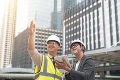 Surveyor builder Engineer with theodolite transit equipment at c stock photography