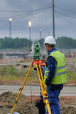 Surveyor builder worker with theodolite Royalty Free Stock Images