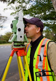 Surveyor checks his work. Surveyor uses his equipment to take measurements for his latest project Stock Photography