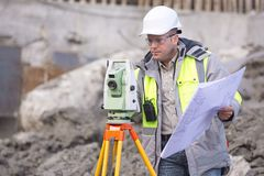 Surveyor At Consruction Site Royalty Free Stock Images