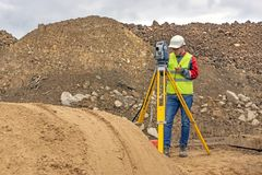 Topographical survey of the terrain by a surveyor royalty free stock photo