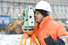 Surveyor at construction site in winter season Stock Photography