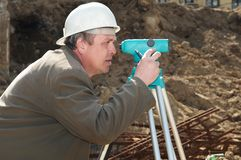 Surveyor at construction work Royalty Free Stock Photos